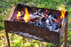 Barbecue filled with coals Royalty Free Stock Photo