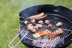 Barbecue filled with grilled meat Stock Image