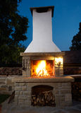Barbecue fireplace. Fireplace in rural house backyard, barbecue grill for roasting food Stock Images