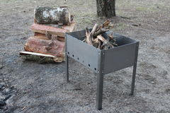 Barbecue with firewood royalty free stock photography