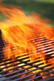 Barbecue with flames and copy space royalty free stock photo
