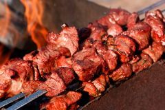 Barbecue or fried pork meat. On bbq Royalty Free Stock Image