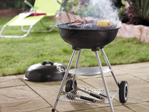 Barbecue in garden stock photo