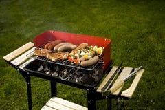 Barbecue in the garden, cook hand Stock Photos