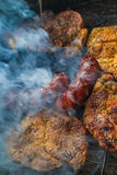 Barbecue garden process cooking meat grill Stock Photo