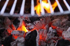 Barbecue Grill. Burning charcoal biscuits set on fire in a barbecue grill Stock Photos