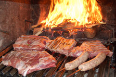 Barbecue grill. A barbecue grill with an assortment of meats and sausages royalty free stock photos