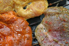 Barbecue grill. Fresh marinated meat on a barbecue grill royalty free stock image