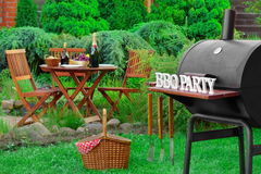 Barbecue Grill Appliance With Tools And BBQ Party Sign Stock Photo