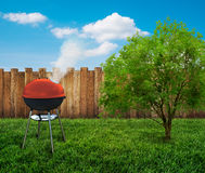 Barbecue grill on backyard Stock Image