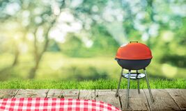 Barbecue grill on backyard and wooden table