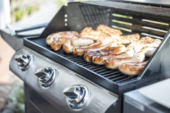Barbecue grill bbq on propane gas grill steaks bratwurst sausages meat meal Royalty Free Stock Photos