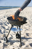 Barbecue grill on beach Stock Photo
