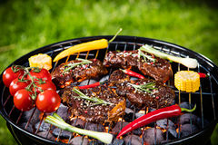 Barbecue grill with beef steaks, close-up. Stock Image