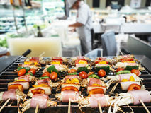 Barbecue grill with Blurred kitchen and chef Stock Image