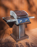 Barbecue grill on cedar deck Stock Photos