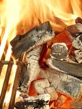 Barbecue grill, charcoal and flames of fire. Stock Image