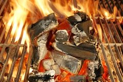 Barbecue grill, charcoal and flames of fire. Royalty Free Stock Photos