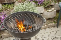 Barbecue grill, charcoal and Flames of Fire Stock Photography
