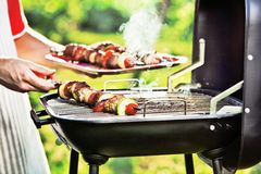 Barbecue Grill. Chef prepares a barbecue on the grill Royalty Free Stock Photography