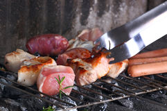 Barbecue grill with chicken and meat Stock Images
