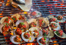 Barbecue Grill Cooked greenshell mussels seafood. Stock Photo