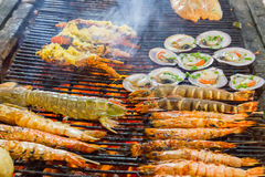 Barbecue Grill cooking shrimp. Royalty Free Stock Photography