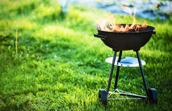Barbecue grill with fire. On nature, outdoor, close up Royalty Free Stock Photography