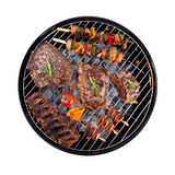 Barbecue grill with meat on white background Royalty Free Stock Photos