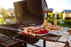 Barbecue grill party. Tasty food on wooden desk. Royalty Free Stock Image