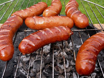 Barbecue grill & sausages - close view Royalty Free Stock Images