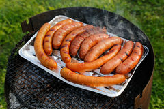 Barbecue grill with sausages on the grill Stock Images