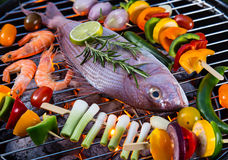Barbecue grill with sea fishes. Stock Image