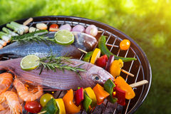 Barbecue grill with sea fishes. Royalty Free Stock Image