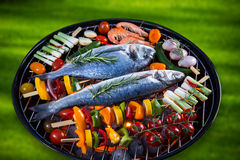 Barbecue grill with sea fishes. Royalty Free Stock Photos