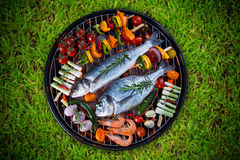 Barbecue grill with sea fishes. Royalty Free Stock Photo