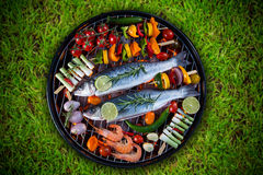 Barbecue grill with sea fishes. Royalty Free Stock Photography