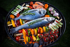 Barbecue grill with sea fishes. Stock Images