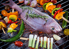 Barbecue grill with sea fishes. Royalty Free Stock Images