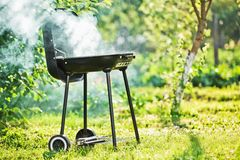 Barbecue Grill. With smoke outdoors Royalty Free Stock Photos