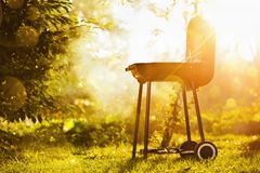 Barbecue Grill. In sunlight in the garden Stock Photography