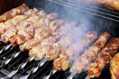 Barbecue grill with various kinds of meat, close-up. Roast Beef Kebabs On BBQ Grill. Barbecue grill with various kinds of meat, close-up Stock Images