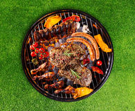 Barbecue grill with various kinds of meat royalty free stock photos