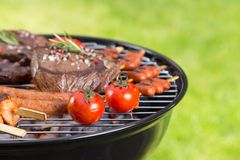 Barbecue grill with various kinds of meat Stock Photos