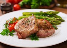 Barbecue grilled beef steak meat with asparagus. And tomatoes Stock Photography
