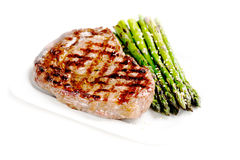 Barbecue grilled beef steak meat with asparagus Stock Photos