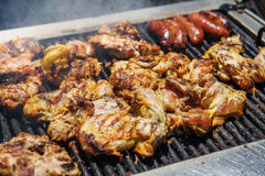 Barbecue Grilled Chicken and sausages Stock Image