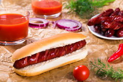 Barbecue Grilled Hot Dog in plain bun Stock Images