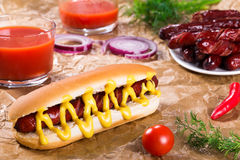 Barbecue Grilled Hot Dog in plain bun Royalty Free Stock Images