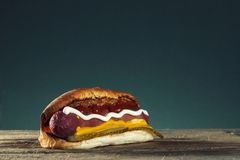 Barbecue Grilled Hot Dog with Yellow Mustard.  Stock Images